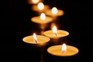 yellow glow of candles on dark background